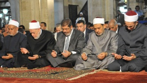 Egypt's Mohamed Morsi, the Grand Sheikh of Al-Azhar Ahmed El-Tayeb, and Egypt's Mufti Ali Gomaa during the Al-Gomaa  prayer at Al-Azhar mosque in Cairo